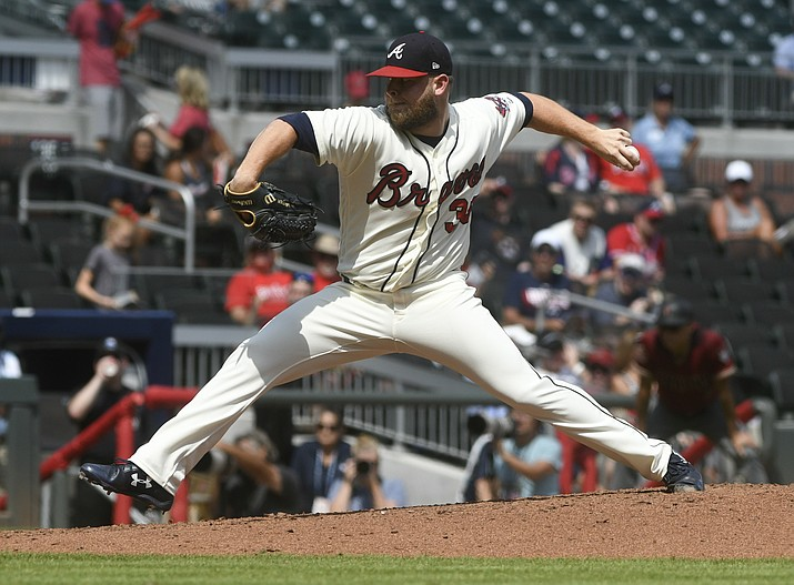 Atlanta Braves pitcher A.J. Minter works the mound against the Arizona Diamondbacks during the ninth inning of a baseball game Sunday, July 15, 2018, in Atlanta. (John Amis/AP Photo)
