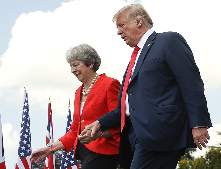 President Donald Trump and British Prime Minister Theresa May hold hands at the conclusion of their joint news conference at Chequers, in Buckinghamshire, England, Friday, July 13, 2018. (Pablo Martinez Monsivais/AP Photo)