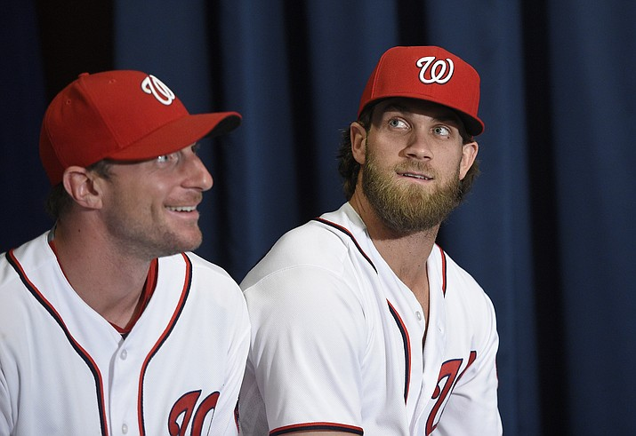 Washington Nationals' Max Scherzer, left, and Bryce Harper look on at a baseball press conference to unveil the 2018 MLB All-Star Game logo, in Washington, D.C., July 26, 2017. (Nick Wass/AP Photo, file)