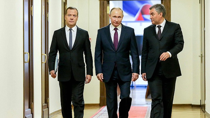 Chairman of the Government DA. Medvedev, President V.V. Putin and the chairman of the State Duma V.V. Volodin in the State Duma on May 8, 2018.  (Photo by duma.gov.ru (duma.gov.ru) [CC BY 4.0  (https://creativecommons.org/licenses/by/4.0)], via Wikimedia Commons)