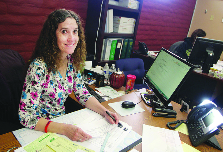 "A self-described ""numbers person,"" Clarkdale-Jerome School District Business Manager Kristy Aston says she enjoys ""making the budget work as much as possible for everyone."" (Photo by Bill Helm)"