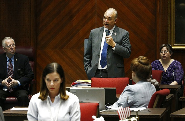 Pictured is Rep. Don Shooter, center background, R-Yuma. Shooter was the first state lawmaker in the country to be expelled in the #MeToo era after he was criticized for a pattern of sexually harassing women. Now he's back, running in the state's Republican primary for a seat in the state Senate. (AP Photo/Ross D. Franklin)
