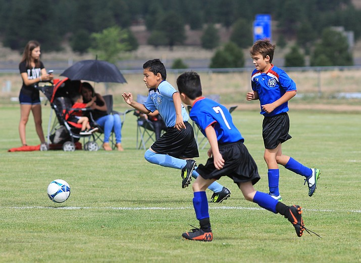 A Williams player dribbles the ball down the field July 14. Williams has four AYSO teams that are participating in the Flagstaff AYSO program.