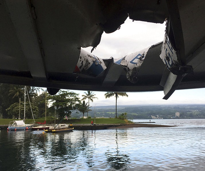 Pictured is damage to the roof of a tour boat after an explosion sent lava flying through the roof off the Big Island of Hawaii Monday, July 16, 2018, injuring at least 23 people. The lava came from the Kilauea volcano, which has been erupting from a rural residential area since early May. (Hawaii Department of Land and Natural Resources)