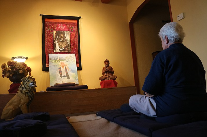 Eileen Steichen demonstrates meditation at Kingman's Humuh Meditation and Dharma Center. (Travis Rains)