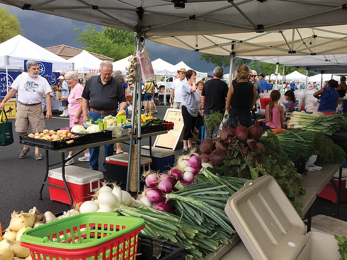 The Prescott Farmers Market did their best to go on despite the rain but were unable to. (Sue Tone/Tribune)