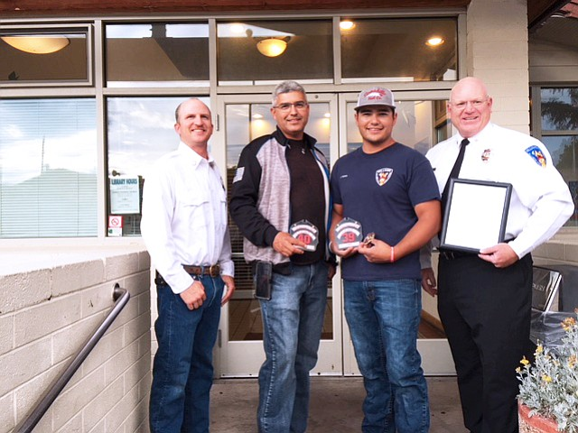 Above: Chase Pearson (far left) and John Moede (far right) honor Kevin Perkins and Jimmy Perkins for their years of service with the Williams Volunteer Fire Department. (Williams Fire/photo)