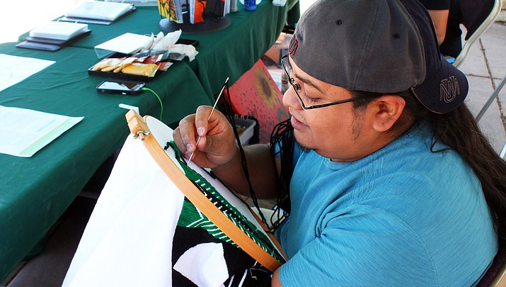 Artisan Elroy Natachu Jr.  uses traditional weaving  methods to link Zuni past and  future generations