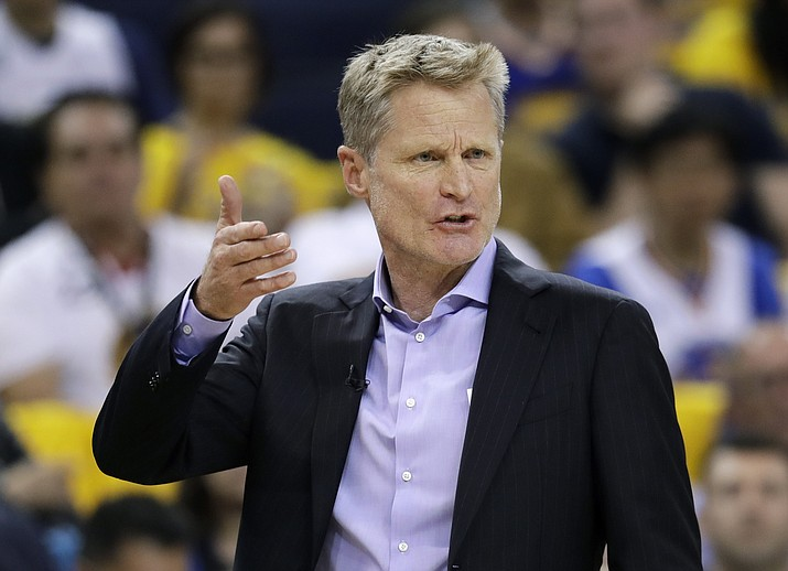 In this Sunday, June 3, 2018 file photo,Golden State Warriors head coach Steve Kerr gestures during the first half of Game 2 of basketball's NBA Finals between the Warriors and the Cleveland Cavaliers in Oakland, Calif.  Golden State Warriors coach Steve Kerr has received a contract extension following the franchise's repeat championship and third title in four years during his tenure. (Marcio Jose Sanchez/AP, File)