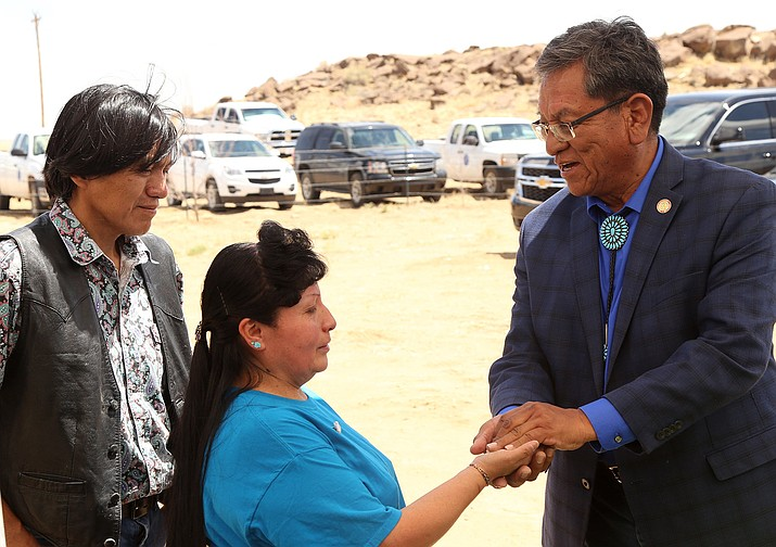 Navajo Nation President Russell Begaye hands the keys to a newly constructed home to Elvira Bitsilly and her husband, Irving Tsosie. The couple's home burned down in March 2017. (Navajo Nation Office of the President and Vice President)