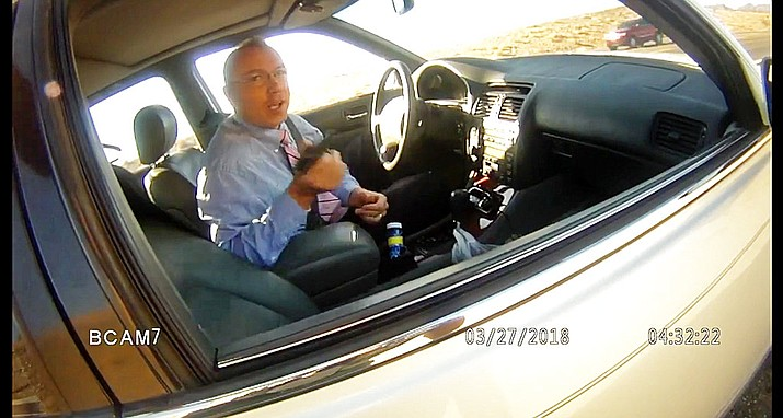 This file image made from a March 27, 2018, law enforcement body camera video shows Arizona state Rep. Paul Mosley during a traffic stop outside Parker, Ariz. Records show an Arizona lawmaker already under fire for claiming legislative immunity during a traffic stop for speeding has had similar run-ins with state police, and only got a warning each time. According to Department of Public Safety documents obtained by The Arizona Republic Tuesday, July 17, 2018, Rep. Paul Mosley was pulled over by troopers six times since February 2017. (La Paz County Sheriff's Office/KLPZ/ParkerLiveOnline via AP, File)