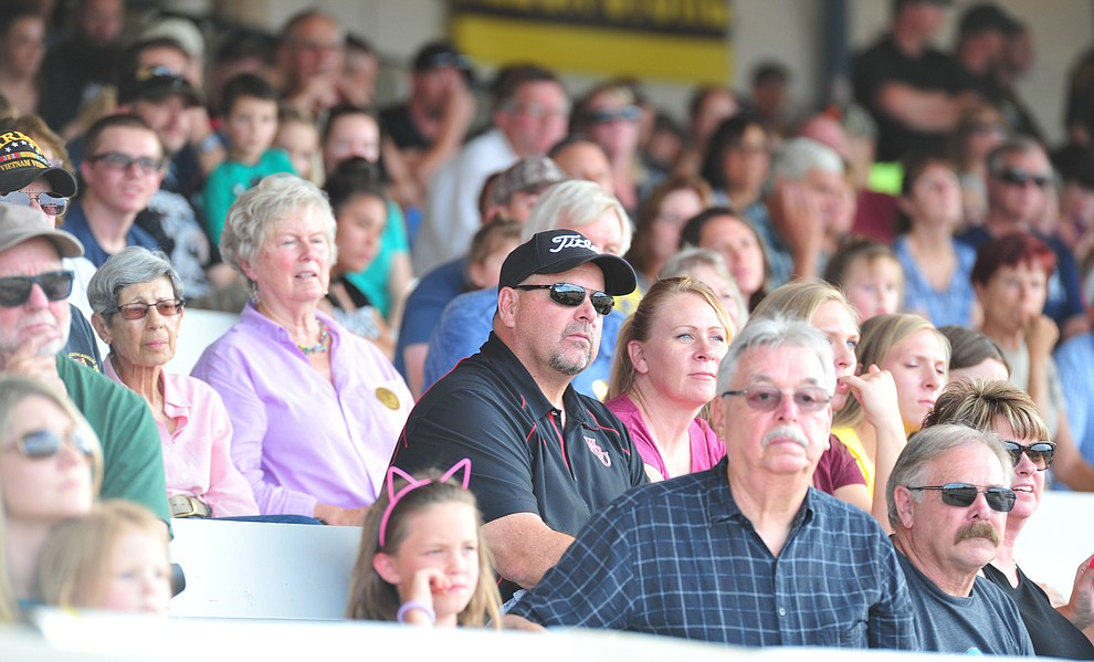 A large crowd watches as police K-9 handlers and their partners from throughout Arizona who are attending the 26th annual Canine Survival Seminar at Yavapai College hold a public demonstration at the Prescott Rodeo Grounds Tuesday, July 17, 2018.(Les Stukenberg/Courier)