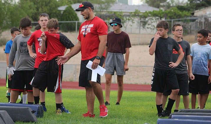 Lee Williams football coach Clint Sasse instructs middle schoolers during a camp Tuesday at LWHS.