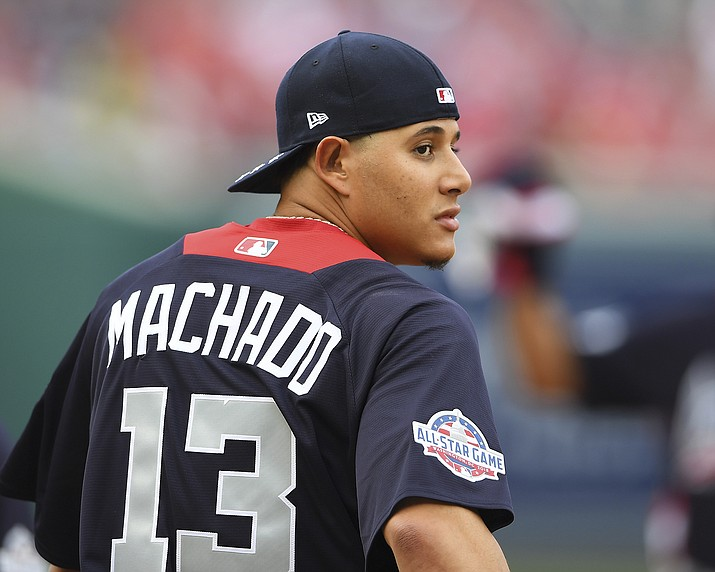 American League, Baltimore Orioles shortstop Manny Machado looks over his shoulder as he walks onto the field before the Major League Baseball All-star Game, Tuesday, July 17, 2018 in Washington. (Nick Wass/AP)