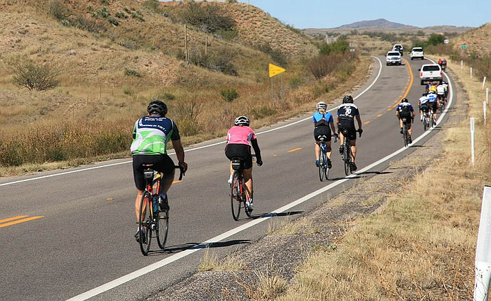 Bicyclists enjoy the scenery on a ride on State Route 82 in southern Arizona. (Photo courtesy of ADOT)
