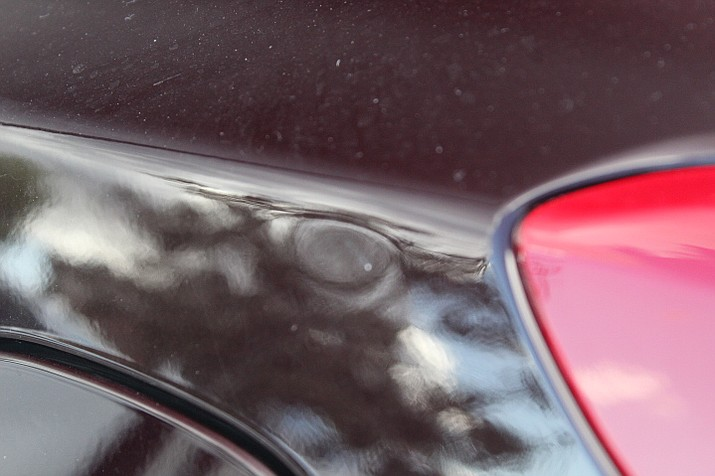 Local car dealerships suffered hail damage in Wednesday's, July 18, storm. Rhett Wagner, general manager at Lamb Chevrolet, said if people are not trained to look for this type of hail damage, they could walk past a white truck and not know it's there. (Rhett Wagner/Courtesy)