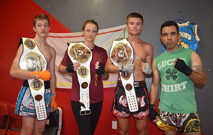 Jonah Loveall, Lauren Willis, Wesley Loveall and Victor Rivas pose with the belts they won last month at the Thai Boxing Association Classic Muay Thai World Expo in Des Moines, Iowa. VVN/James Kelley