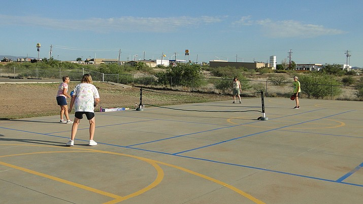 Four people play pickleball, which is a combination of tennis, badminton and volleyball. (Courtesy)