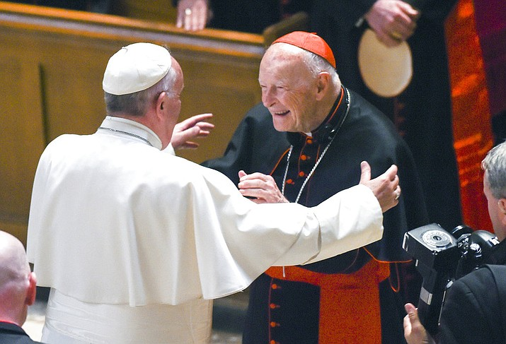 In this 2015 file photo, Pope Francis reaches out to hug Cardinal Archbishop emeritus Theodore McCarrick after the Midday Prayer of the Divine with more than 300 U.S. Bishops at the Cathedral of St. Matthew the Apostle in Washington. Allegations that the most respected U.S. cardinal repeatedly sexually abused both boys and adult seminarians has raised questions about who in the Catholic Church hierarchy knew, and what Pope Francis is going to do about it. (Jonathan Newton/The Washington Post via AP, Pool, File)