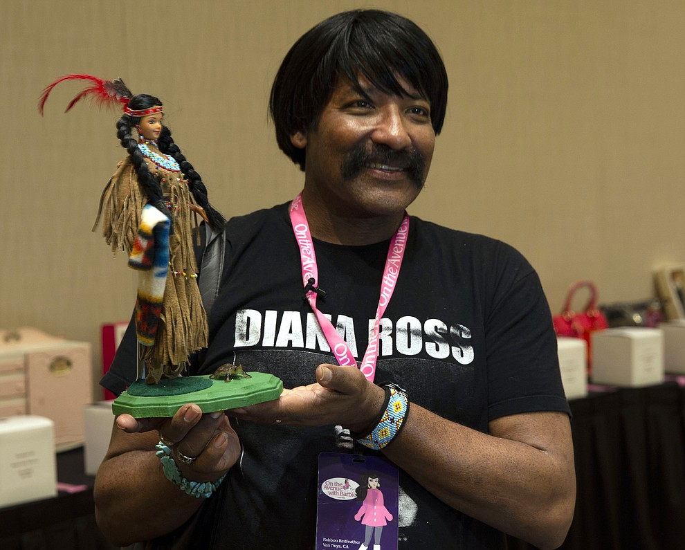 Pabboo Redfeather, a designer and artist, says he has been collecting Barbies since he was 5 and started a Black Barbie club in 1980. (Photo by Vivian Meza/Cronkite News)