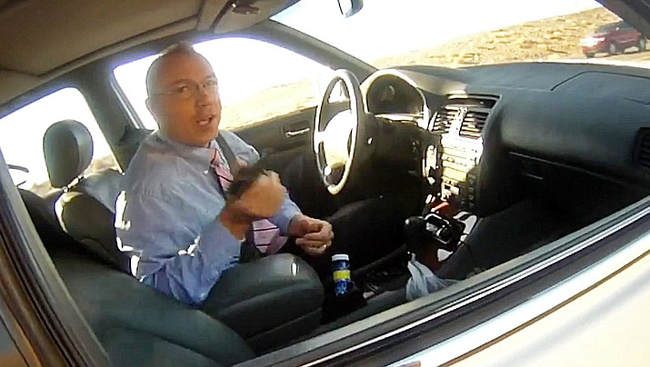 This image made from a March 27, 2018, law enforcement body camera video shows Arizona state Rep. Paul Mosley during a traffic stop outside Parker, Ariz. Records show an Arizona lawmaker already under fire for claiming legislative immunity during a traffic stop for speeding has had similar run-ins with state police, and only got a warning each time. According to Department of Public Safety documents, Rep. Paul Mosley was pulled over by troopers six times since February 2017. (La Paz County Sheriff's Office/KLPZ/ParkerLiveOnline)