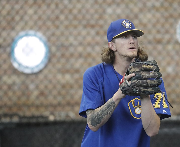 Milwaukee Brewers relief pitcher Josh Hader warms up before a baseball game against the Los Angeles Dodgers Friday, July 20, 2018, in Milwaukee. (Morry Gash/AP)