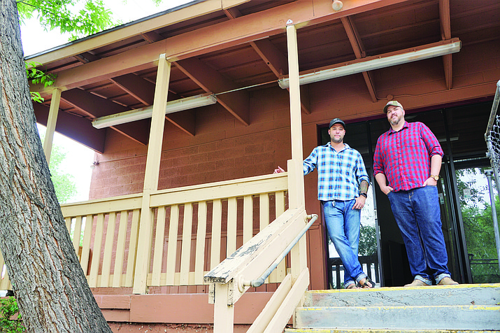 Grant Quezada, left, and Jesse Burke, right, stand on the deck of the 218 N. Granite St. building that they are renovating to serve as the new Founding Fathers Concept – a barbershop/taproom/coffee shop/speakeasy that will bring business activity to the Greenways area. They say the business should be open by spring 2019. (Cindy Barks/Courier)