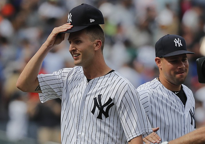 New York Yankees relief pitcher Chasen Shreve, left, tips his cap as he walks off the field at the end of a baseball game against the New York Mets, Saturday, July 21, 2018, in New York. (Julie Jacobson/ap)