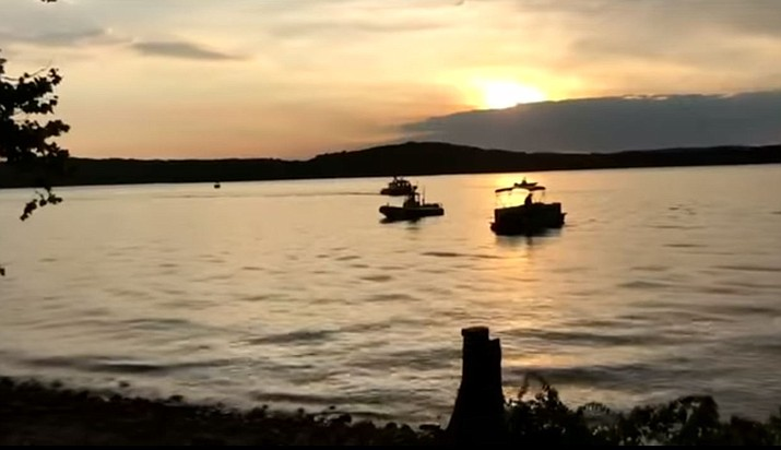 A tourist boat sank into a Missouri lake, killing 17 people Thursday. A huge wave hit, scattering passengers on the vessel known as a duck boat into Table Rock Lake near Branson. (Screenshot from the Associated Press)
