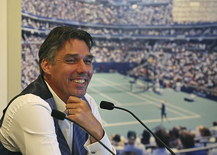Tennis Hall of Fame inductee Michael Stich, of Germany, smiles during a news conference at the International Tennis Hall of Fame, Saturday, July 21, 2018, in Newport, R.I. (Elise Amendola/AP)