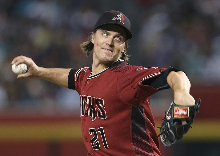 Arizona Diamondbacks starting pitcher Zack Greinke throws against the Colorado Rockies during the first inning of a baseball game, Sunday, July 22, 2018, in Phoenix. (Ralph Freso/AP Photo)