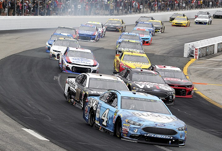 Kevin Harvick races with the pack during a NASCAR Cup Series auto race Sunday, July 22, 2018, at New Hampshire Motor Speedway in Loudon, N.H. (Mary Schwalm/AP PHOTO)