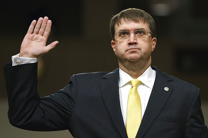 In a Wednesday, June 27, 2018 file photo, Veterans Affairs Secretary nominee Robert Wilkie is sworn in at the start of a Senate Veterans Affairs Committee nominations hearing on Capitol Hill in Washington. Wilkie is expected to become secretary of Veterans Affairs when the Senate votes Monday, July 23 to confirm him. (AP Photo/Carolyn Kaster, File)