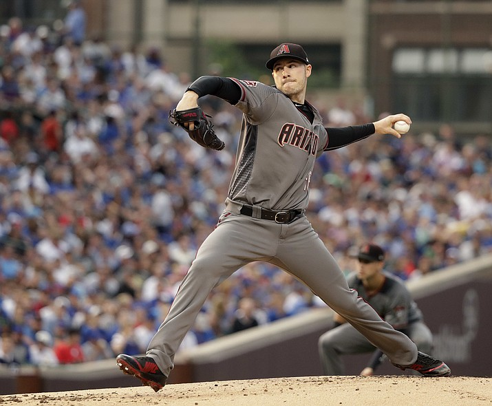 Arizona Diamondbacks starting pitcher Patrick Corbin delivers during the first inning of a baseball game against the Chicago Cubs Monday, July 23, 2018, in Chicago. (Charles Rex Arbogast/AP Photo)
