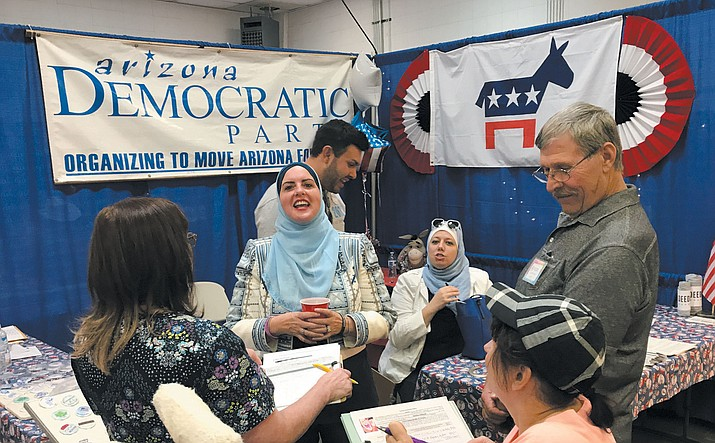 Deedre Abboud, center, Democratic candidate for U.S. Senate, speaks at the Democrats booth at Mohave County Fair in September. (Daily Miner file photo)