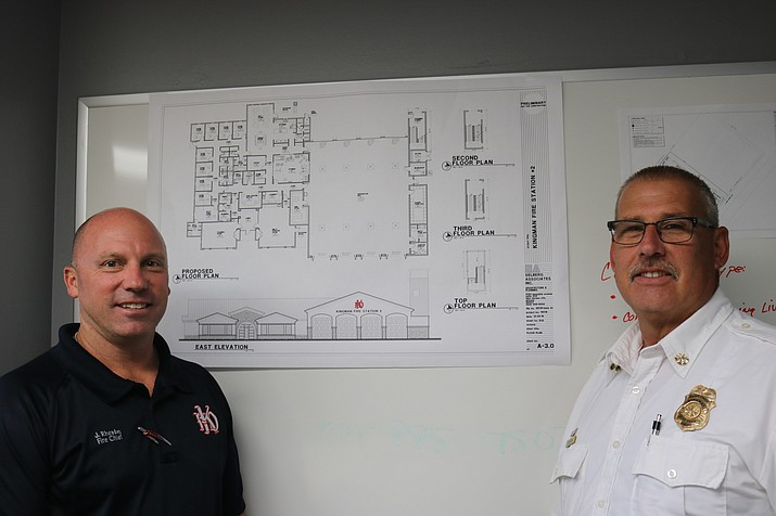 Kingman Fire Chief Jake Rhoades (left) and Assistant Chief Keith Eaton pose with proposed plans for the new, $4.5 million station 22 and training facility. (Travis Rains/Daily Miner)