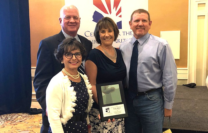 Clarkdale Town Manager Gayle Mabery (center) with her husband, Scott, and Clarkdale Town Council Member Bill Regner and his wife, Janet. Photo courtesy of Bill Regner
