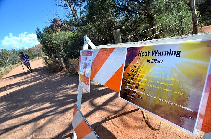 The Forest Service warned hikers about the extreme heat at the trail leading to Bell Rock in the Village of Oak Creek on Monday. Temperatures are to hit 109 in COTTONWOOD and 104 in SEDONA today according to the National Weather Service. VVN/Vyto Starinskas