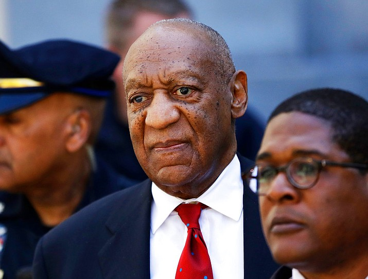 In this April 26, 2018 file photo, Bill Cosby, center, leaves the the Montgomery County Courthouse in Norristown, Pa. A representative from the Sexual Offenders Assessment Board has issued an assessment recommending that Bill Cosby be classified as a sexually violent predator. Cosby, 81, was convicted April 26 on sexual assault charges related to accusations he had drugged and assaulted Andrea Constand in his home in 2004. He is scheduled for sentencing on Sept. 24. (AP Photo/Matt Slocum, File)