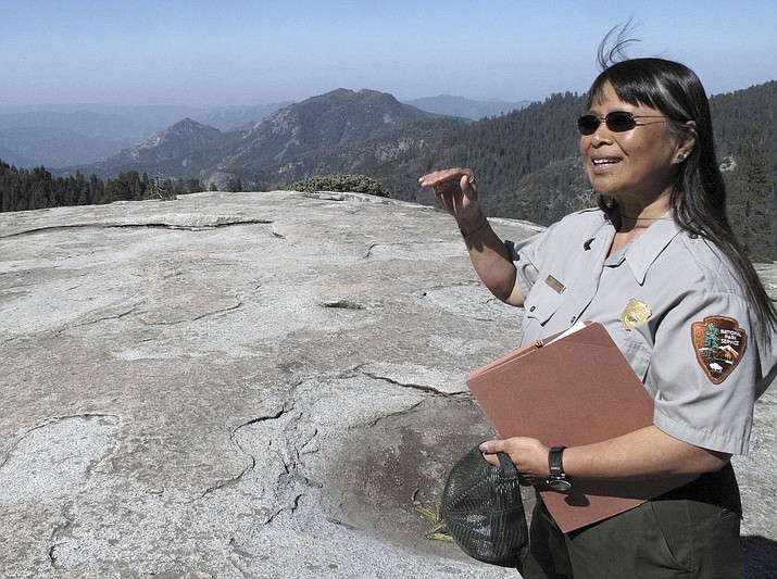 Sequoia National Park air resource specialist Annie Esperanza explains how ozone diminishes the view from Beetle Rock in Sequoia National Park, California.  A new study concludes visitors may be steering clear of some U.S. national parks or cutting their visits short because of pollution. (Photo/AP)