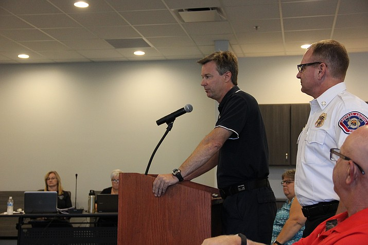 Scott Bliss, chief of planning and logistics for the Central Arizona Fire and Medical Authority, presents an information technology (IT) audit report to the organization's board of directors Monday, July 23. Standing next to Bliss is CAFMA Fire Chief Scott Freitag. (Max Efrein/Courier)