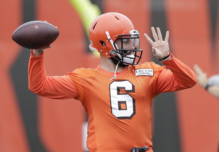 This June 12, 2018 photo shows Cleveland Browns quarterback Baker Mayfield throwing during practice at the NFL football team's training camp facility in Berea, Ohio. The Browns have signed Mayfield to his rookie contract. The Heisman Trophy winner from Oklahoma signed Tuesday, July 24, 2018 a day before Cleveland's players are due to report to training camp. (Tony Dejak/AP Photo)