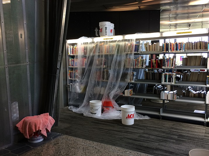 Plastic protects books and shelves in the Teen section of Prescott Valley Public Library July 18 after skylights leaked during recent storms. (Sue Tone/Courier)