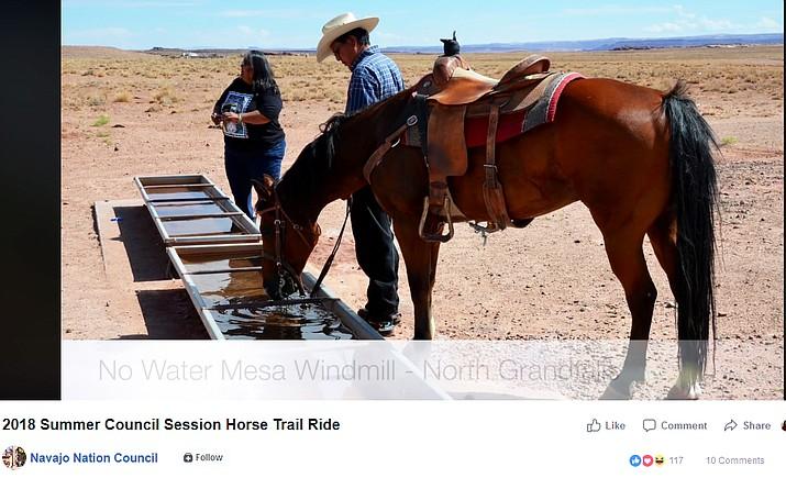 A screenshot of a video taken by the Navajo Nation Council shows Walter Phelps watering his horse at No Water Mesa Windmill north of Grand Falls, Arizona. (Photo/screenshot of Navajo Nation facebook video)