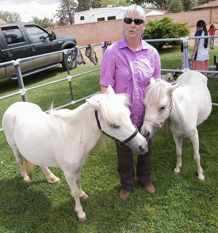 Ybarra with her miniature horses used in coaching at Winslow Library July 10. (Todd Roth/NHO)