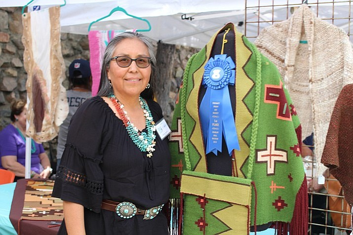 Tahnibaa Naataanii took first place in the traditional arts division with her weaving. (Stan Bindell/Navajo-Hopi Observer)