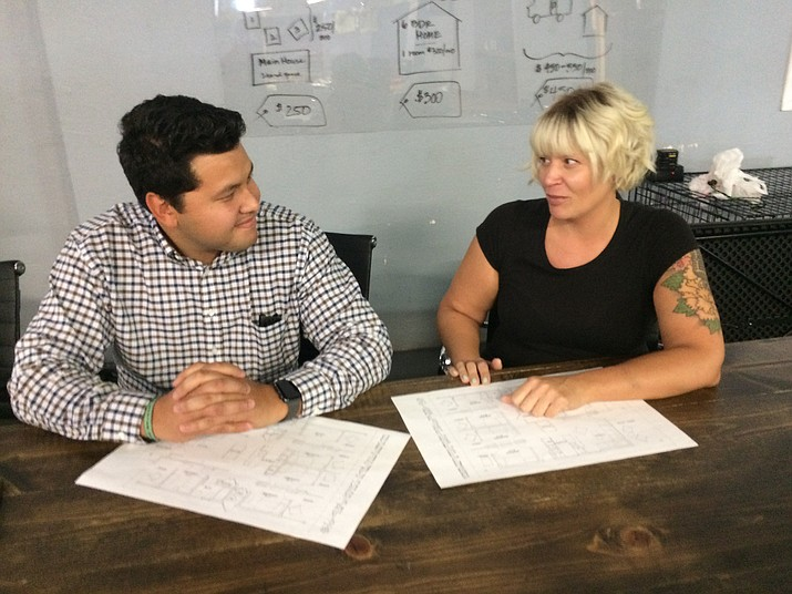 Prescott Realty Co-Owner Jon Rocha works with Coalition for Compassion and Justice Executive Director Jessi Hans on a new affordable housing venture. He is now the agency's volunteer affordable housing developer. (Nanci Hutson/Courier)