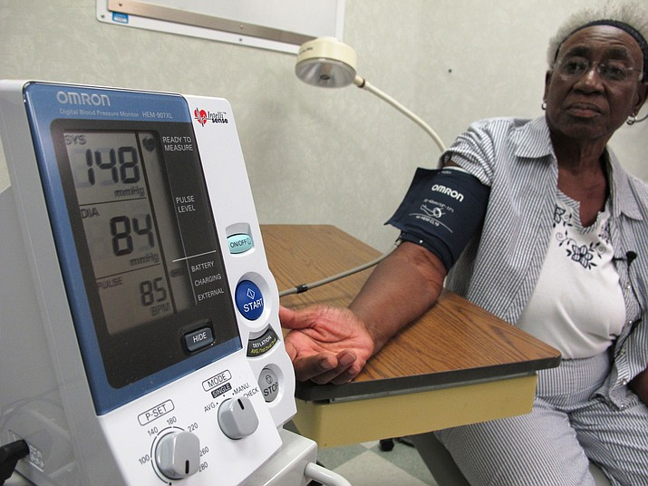 """Margaret Graham, 74, has her blood pressure checked while visiting the Wake Forest Baptist Medical Center in Winston-Salem, N.C., on Friday, July 13, 2018. She had participated in a multi-year study, published on Wednesday, July 25, 2018, investigating a connection between high blood pressure and the risk of mental decline. """"I feel like maybe with this study, some findings may come that will develop new drugs and also new activities, exercise, theories that will help people to maintain an acceptable blood pressure level,"""" Graham says. (AP Photo/Allen G. Breed)"""