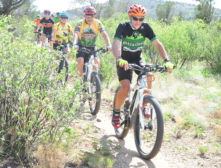 David Price leads a group of E-bikers as they hit the trails at Brownlow Park in Prescott Tuesday, July 24, 2018. (Les Stukenberg/Courier)