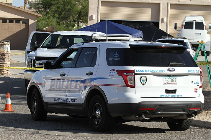 Lake Havasu City Police officers cordoned off the area of Rainbow Lane Wednesday morning after an officer-involved shooting left one man dead. (Brandon Messick/For the Daily Miner)